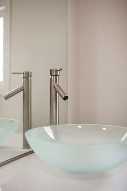 The master bath features a glass vessel sink.