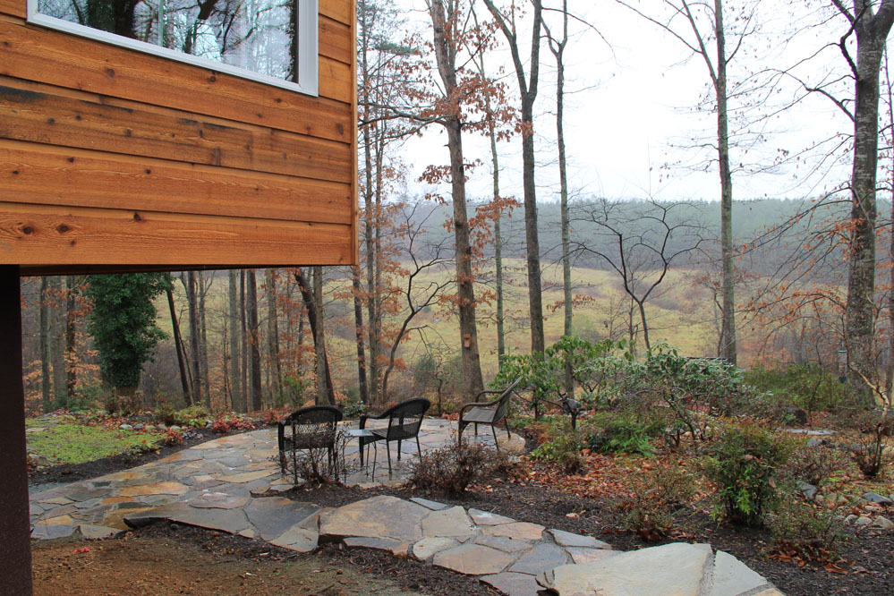 Outdoor spaces take advantage of the native landscape and topography.