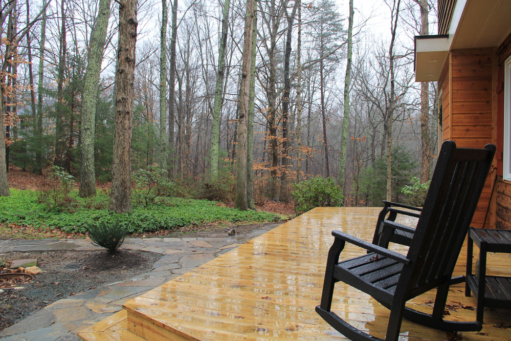 A new front porch provides an idyllic place to enjoy sunrise in the forest.