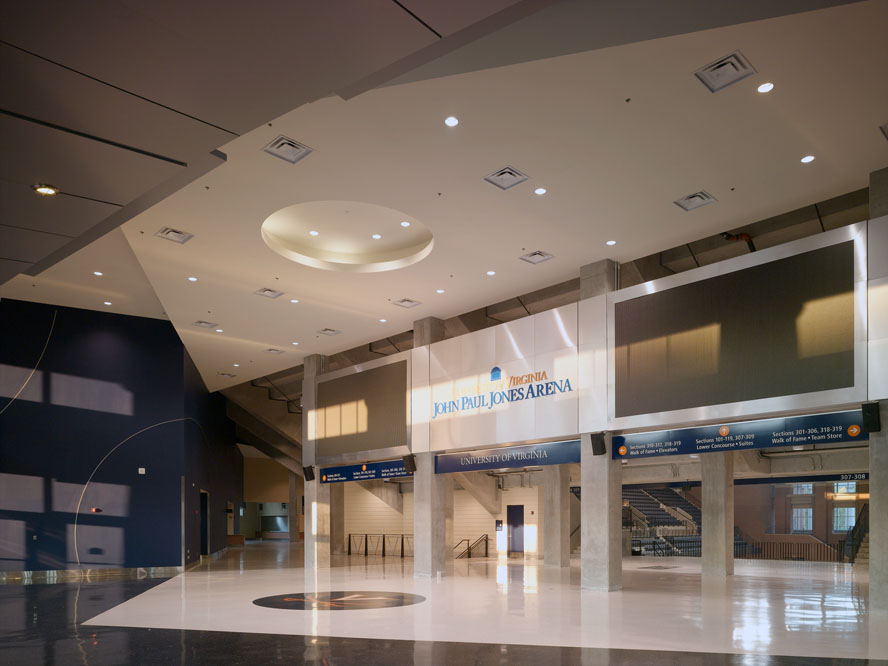 The expansve lobby, here touched by the setting sun,  offers direct views to the seating bowl and event floor.