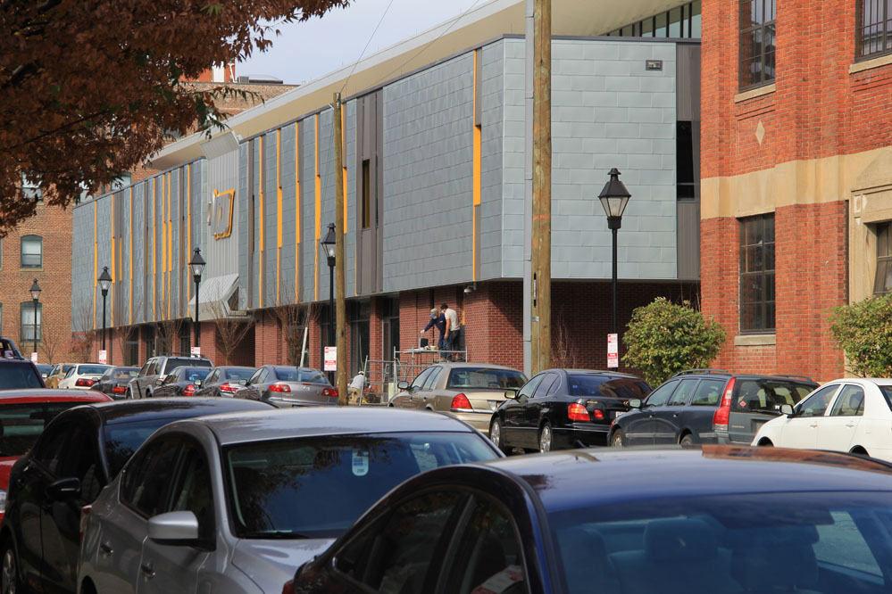 The new facility spans a full block, book-ended by early twentieth century industrial buildings.