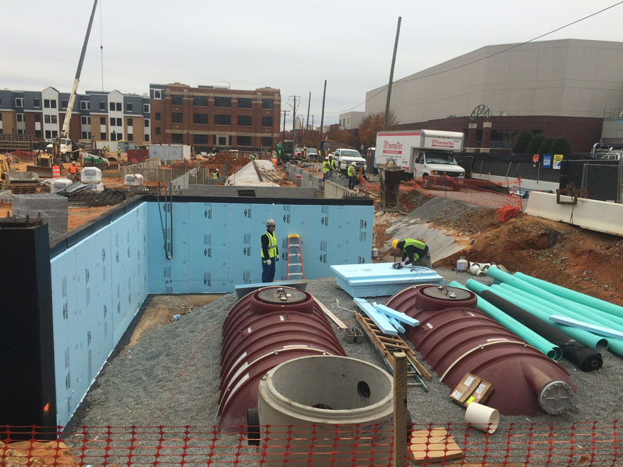 Rainwater harvesting tanks reduce stormwater runoff and provide non-potable irrigation water for the site landscaping.