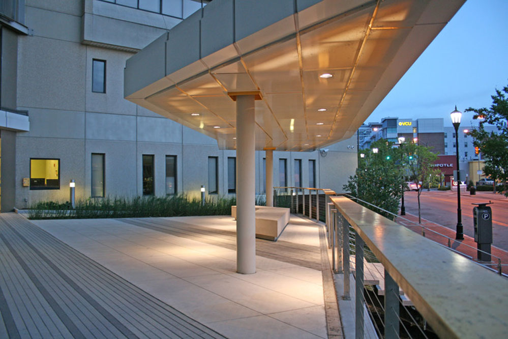 The internally-lit plaza canopy provides shelter and shade for residents.