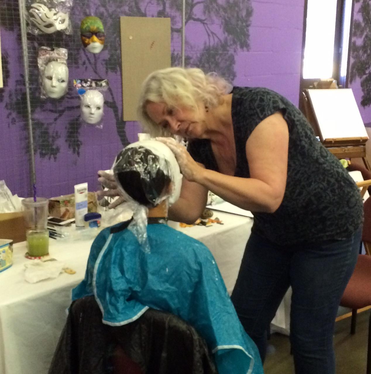 Carol Faber-Peake making a mask