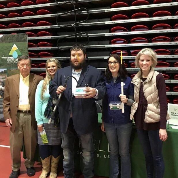 Crop per drop winner Morris Family Farms (left) receiving Trellis soil moisture equipment from Mary Blomgren and Trellis CEO, Liz Buchen