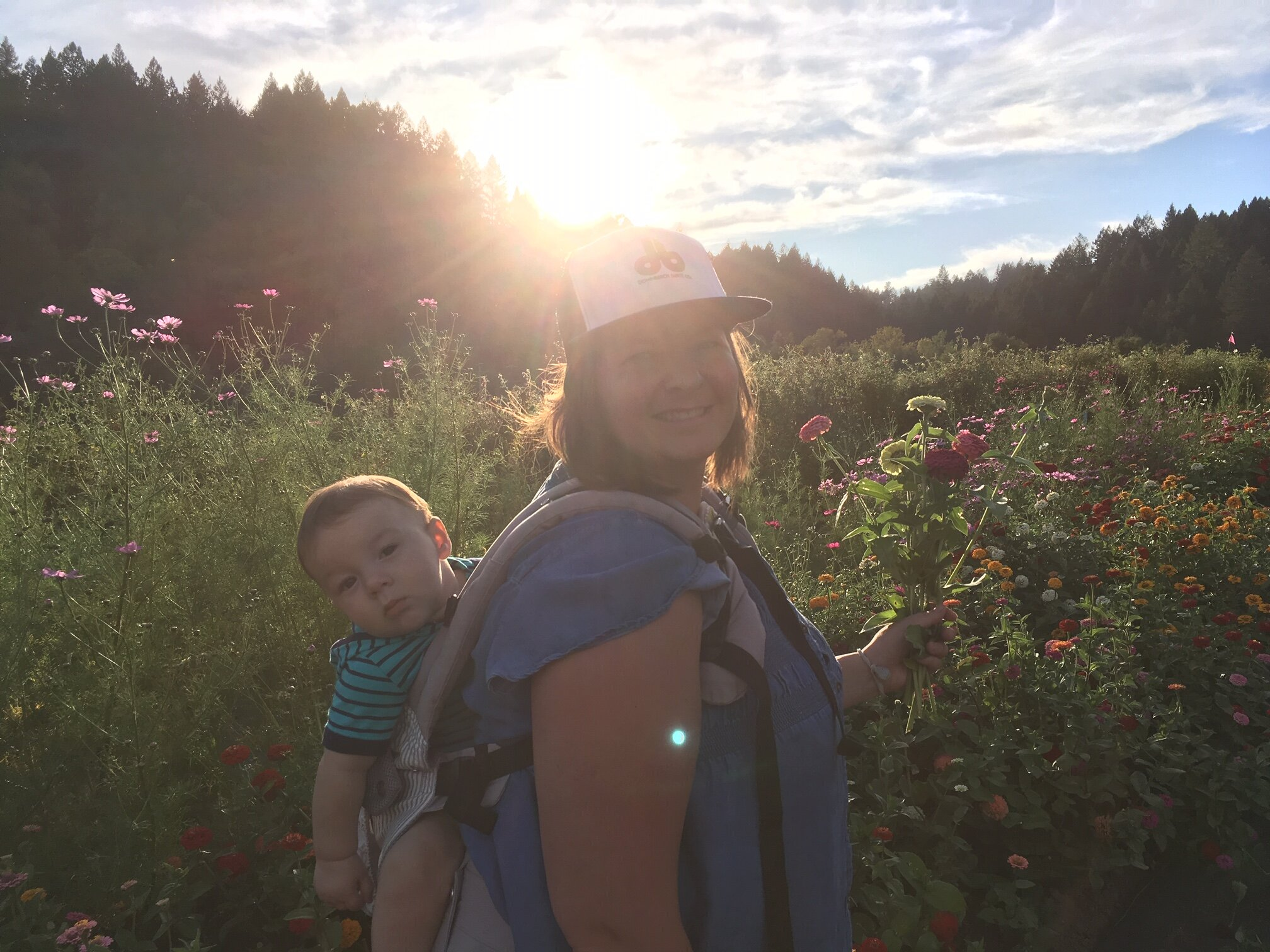 Hannah and Leland picking zinnias at golden hour