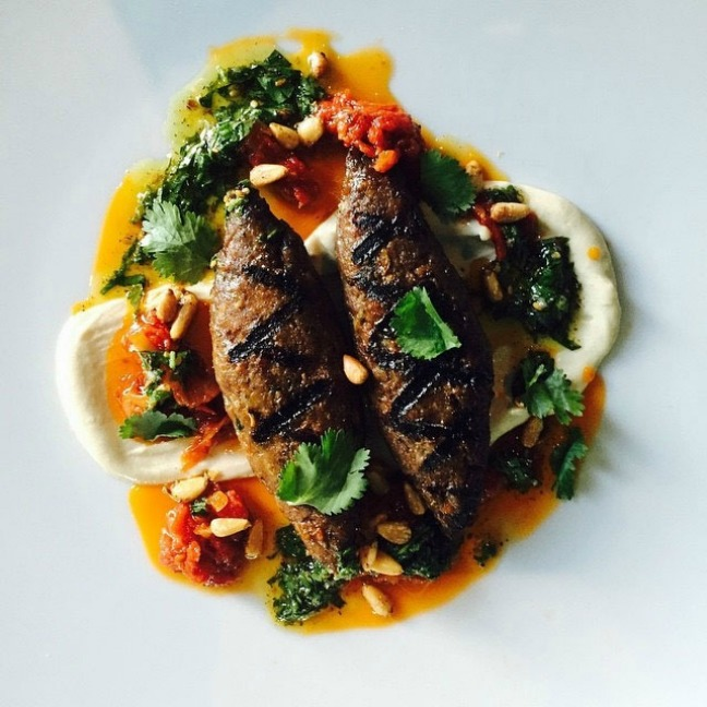 Lamb Kebabs over tahini, tomatoes and cilantro