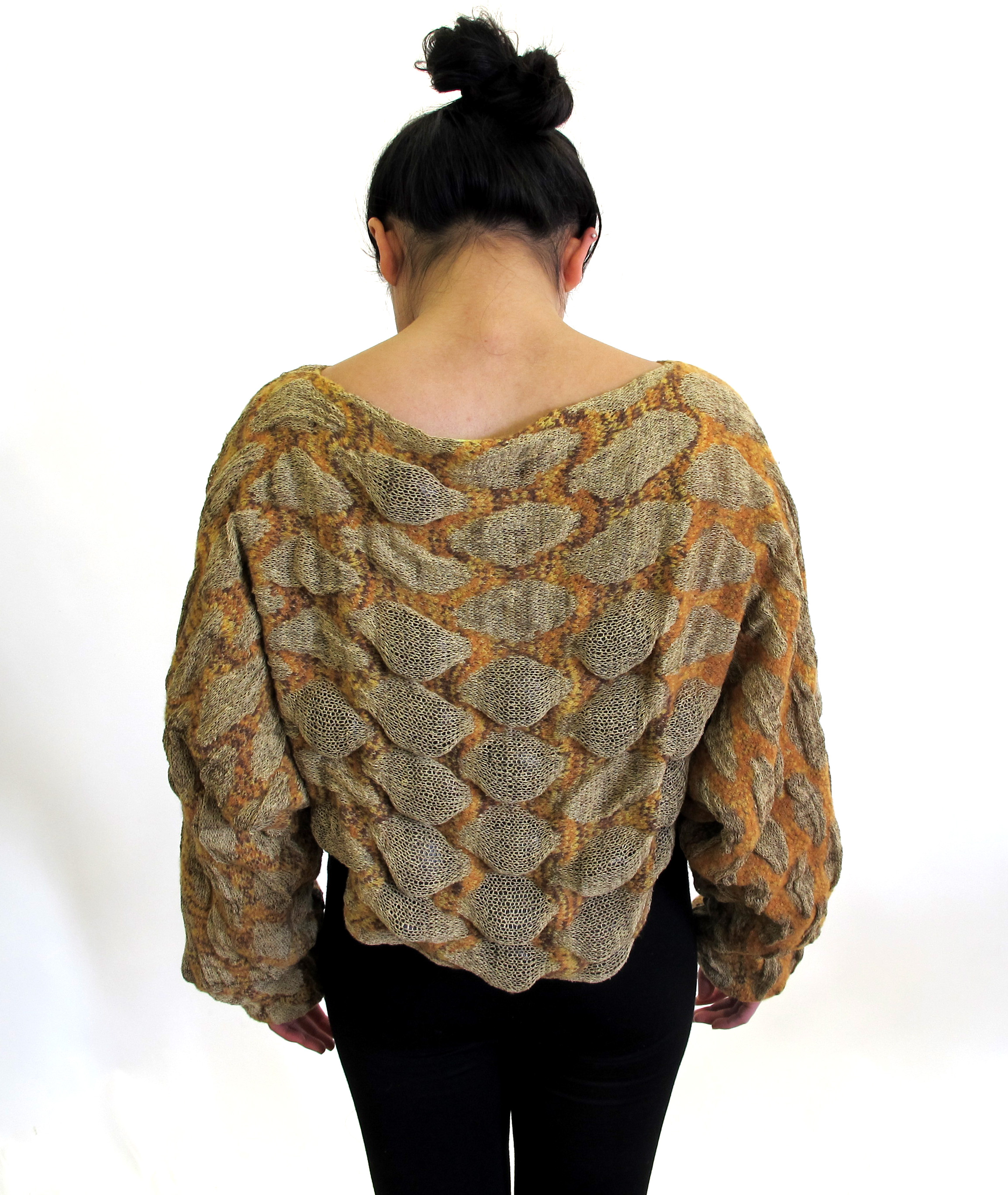 Knit linen and wool garment with seed pods.
