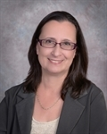 Lois Prevett-McCarthy with NextHome Signature Realty.