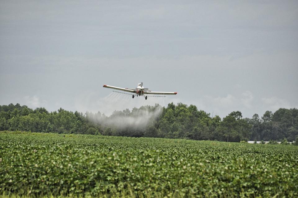 Plane Sprays Pesticides