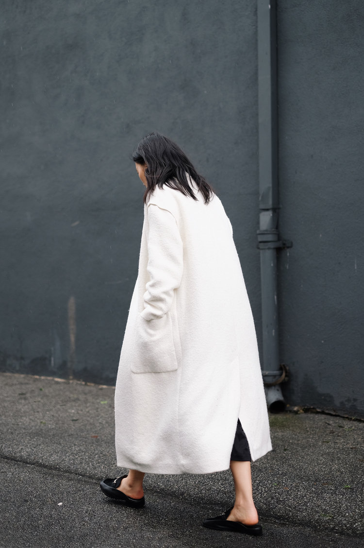 MANGO  Coat  / LEMAIRE  Dress  / NEWBARK   Mules   / KAT KIM   Earring   / SARAH AND SEBASTIAN  Earring  — See post   here