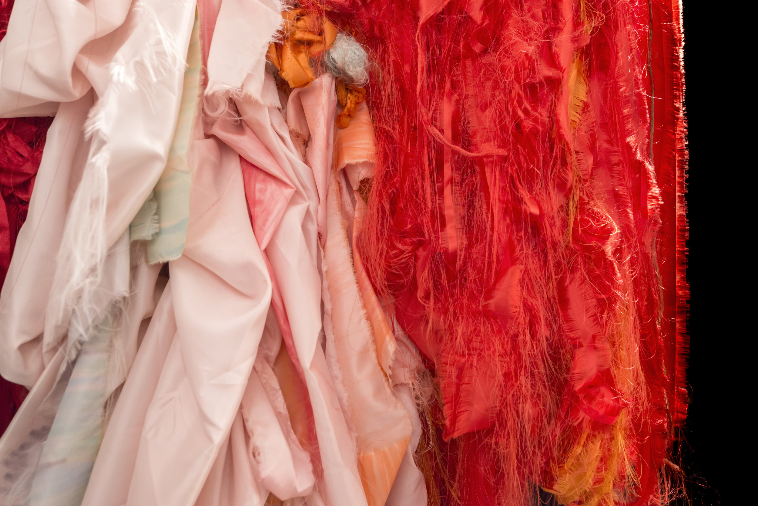 Elin Melberg    Float (red)  , 2015 (detail)   Torn textile, embroidery, dry pastel, wood   Dimensions variable