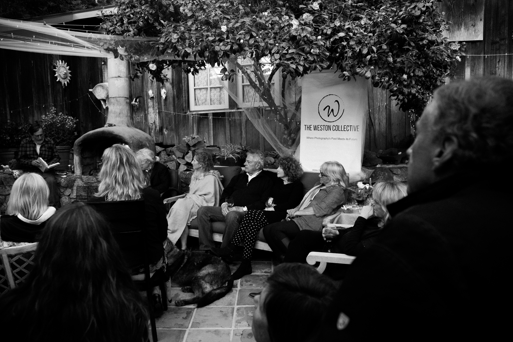 Supporters of The Weston Collective listen as Elliot Roberts recites poems by Robinson Jeffers and reads from Edward Weston's  Daybooks.