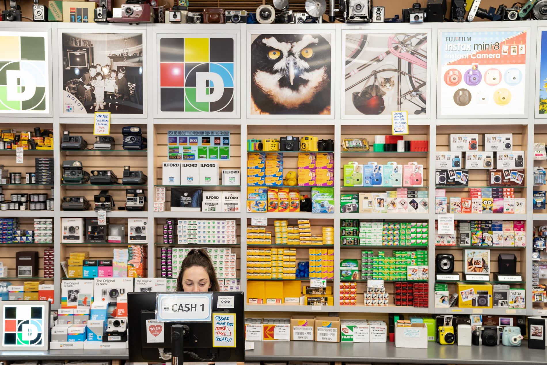 Downtown Camera has expanded its wall of film and cameras from just a few shelves to an entire wall behind the sales desk. This photo was taken on a digital camera.  MELISSA TAIT/THE GLOBE AND MAIL