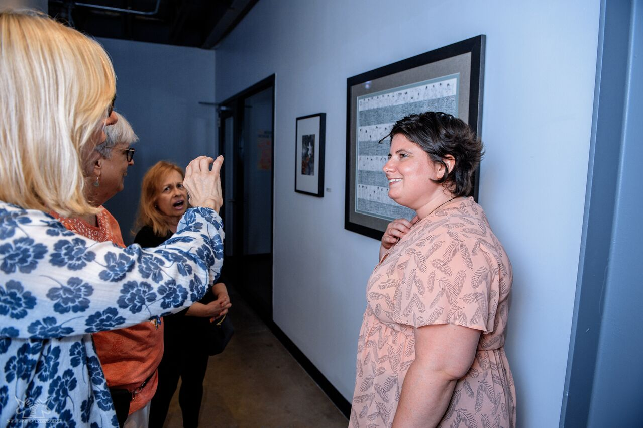 Another artist from the show and her friends (one of whom was a former teacher from  MICA  who told me a lot about on how to frame and preserve fine art pieces) taking a photo of me.