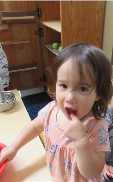Harlow, pointing to her mouth.PNG