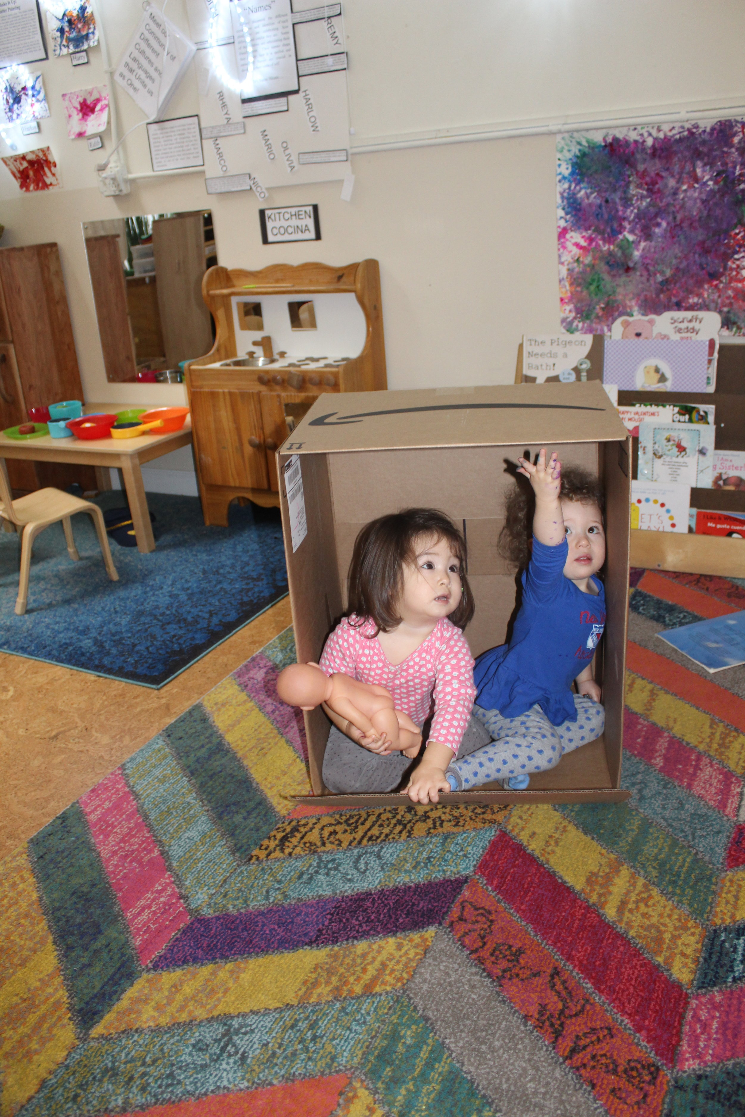 Remy looked curious and interested as she sat in the box. Soon, Rheya joined Remy in the box. The box appeared small for both children, but they both managed to create sufficient space.  It seemed that the two of them had a lot of fun sitting together sharing the space!