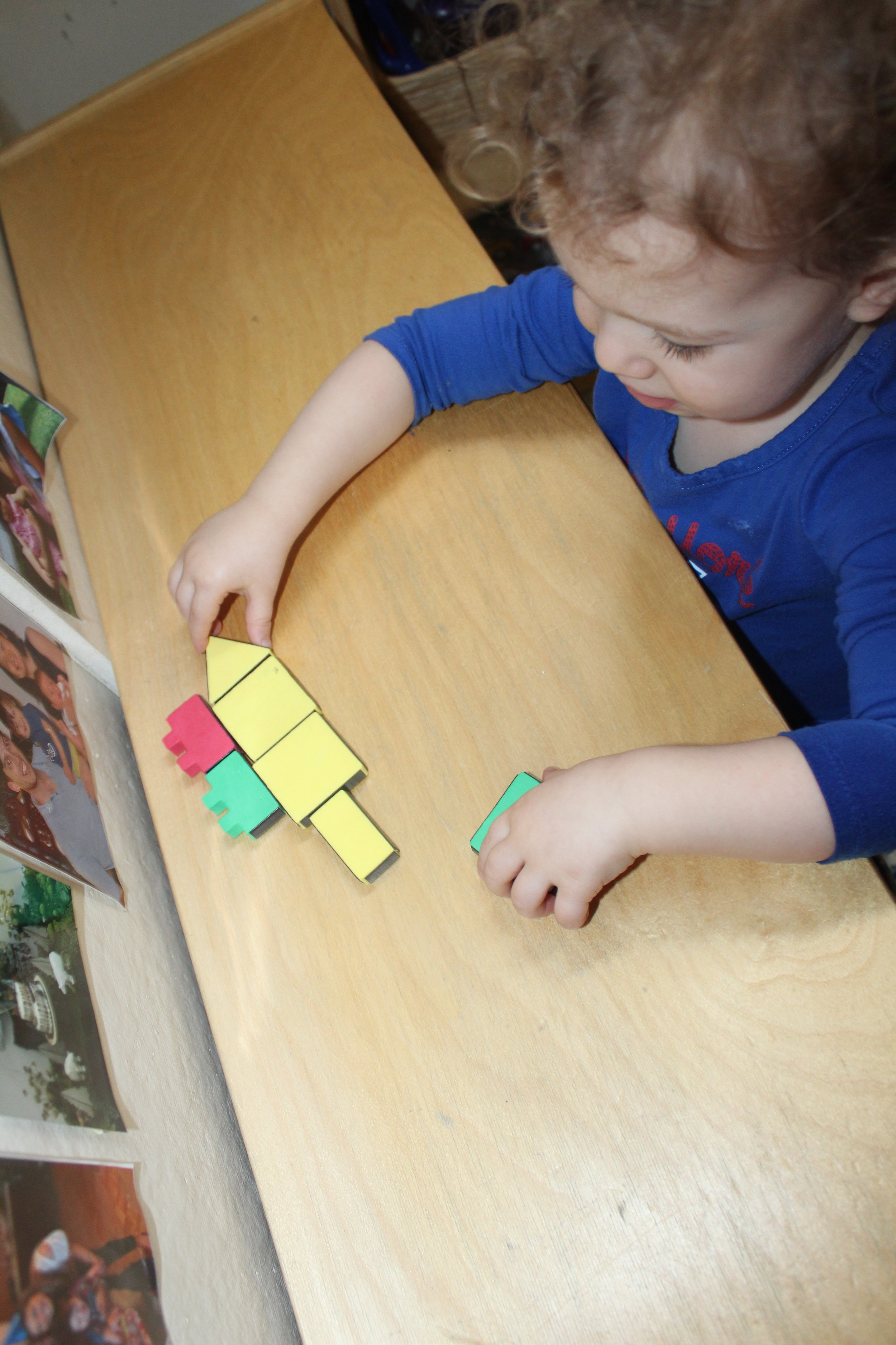 """As Remy connects the shape, she said """"Square shapes!! A house!"""""""