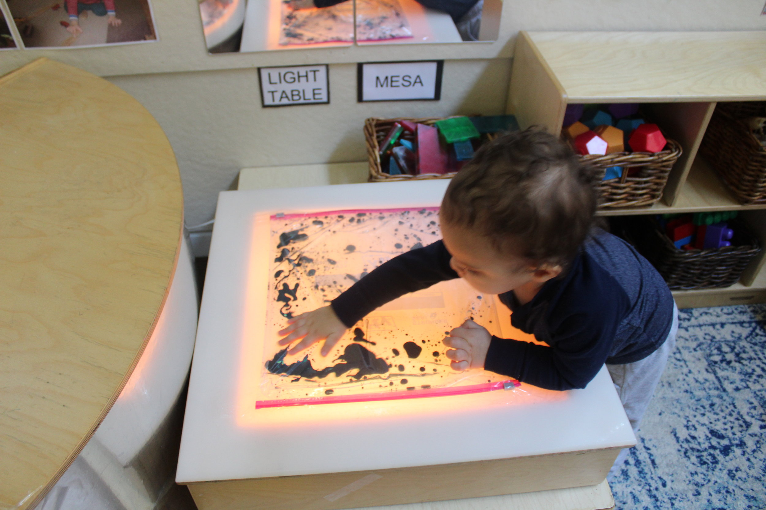 Exploring Sensory Bag: The bag contained baby oil, water,and blue watercolor.