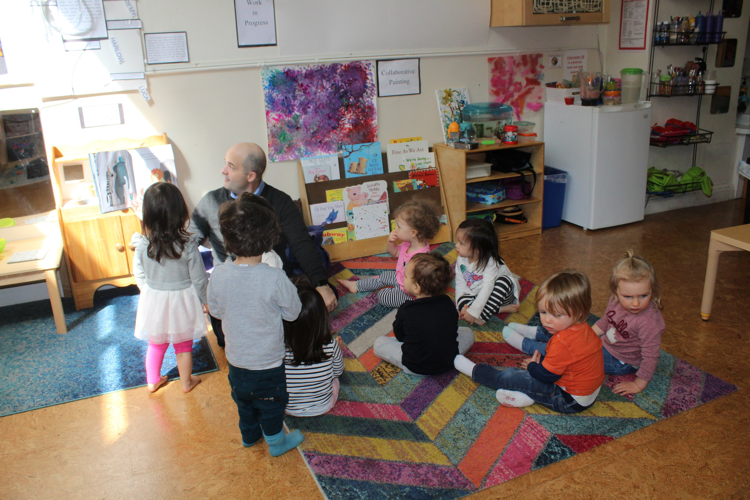 Arturo, Mario's father came to read to the children after lunch. The children were excited to see and hear him read.