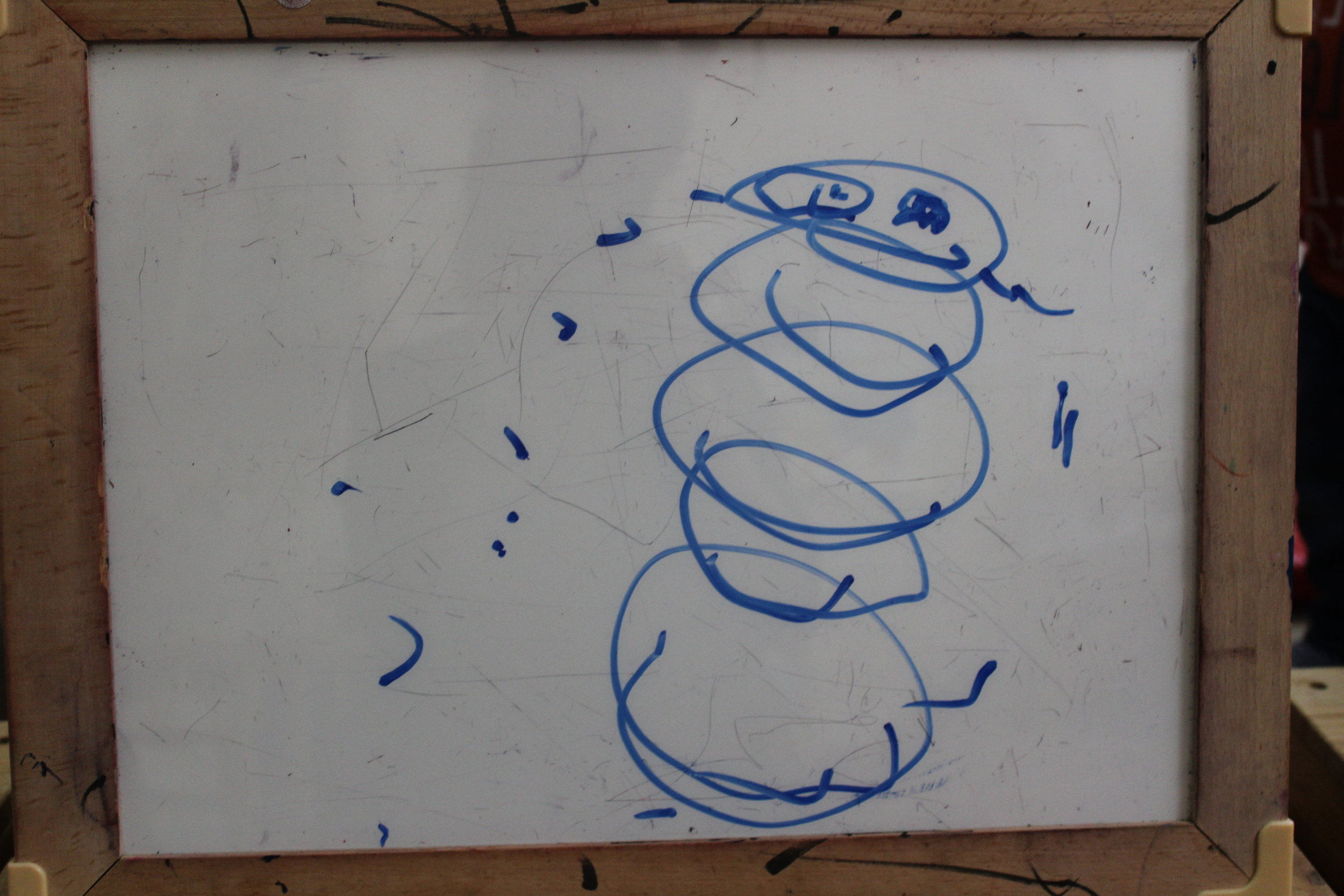 Harry drew a snowman on the erasable board!
