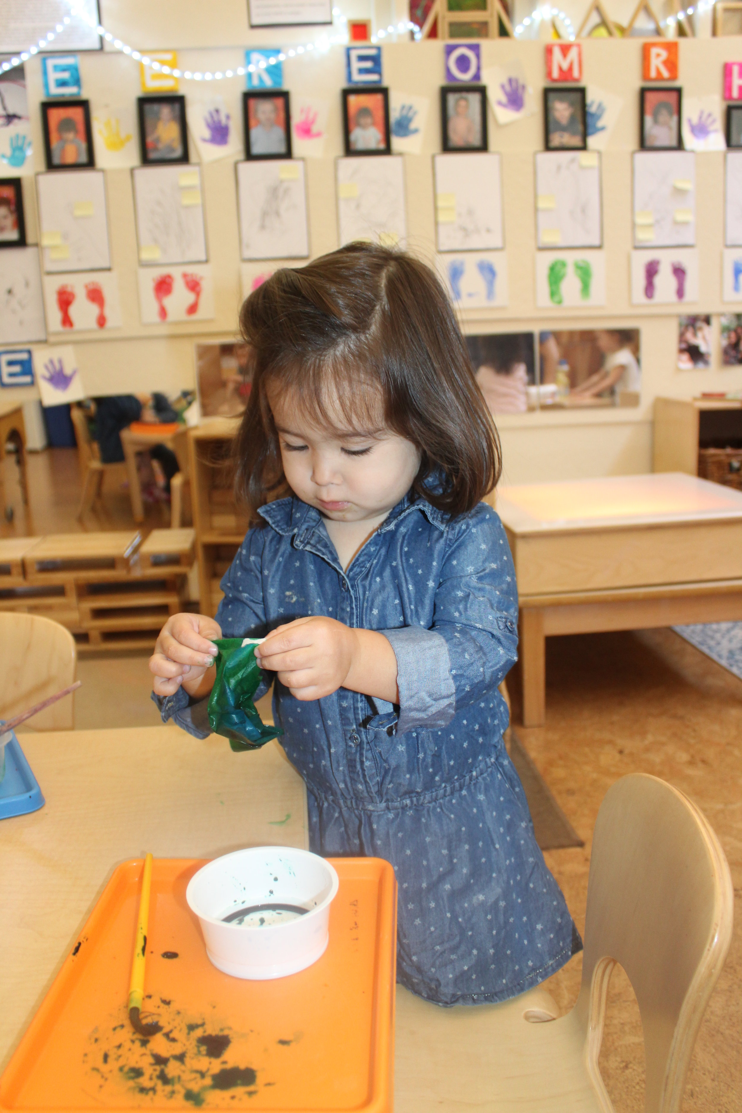 Earth Day activity, using coffee filter paper, blue and green watercolor, representing the earth.
