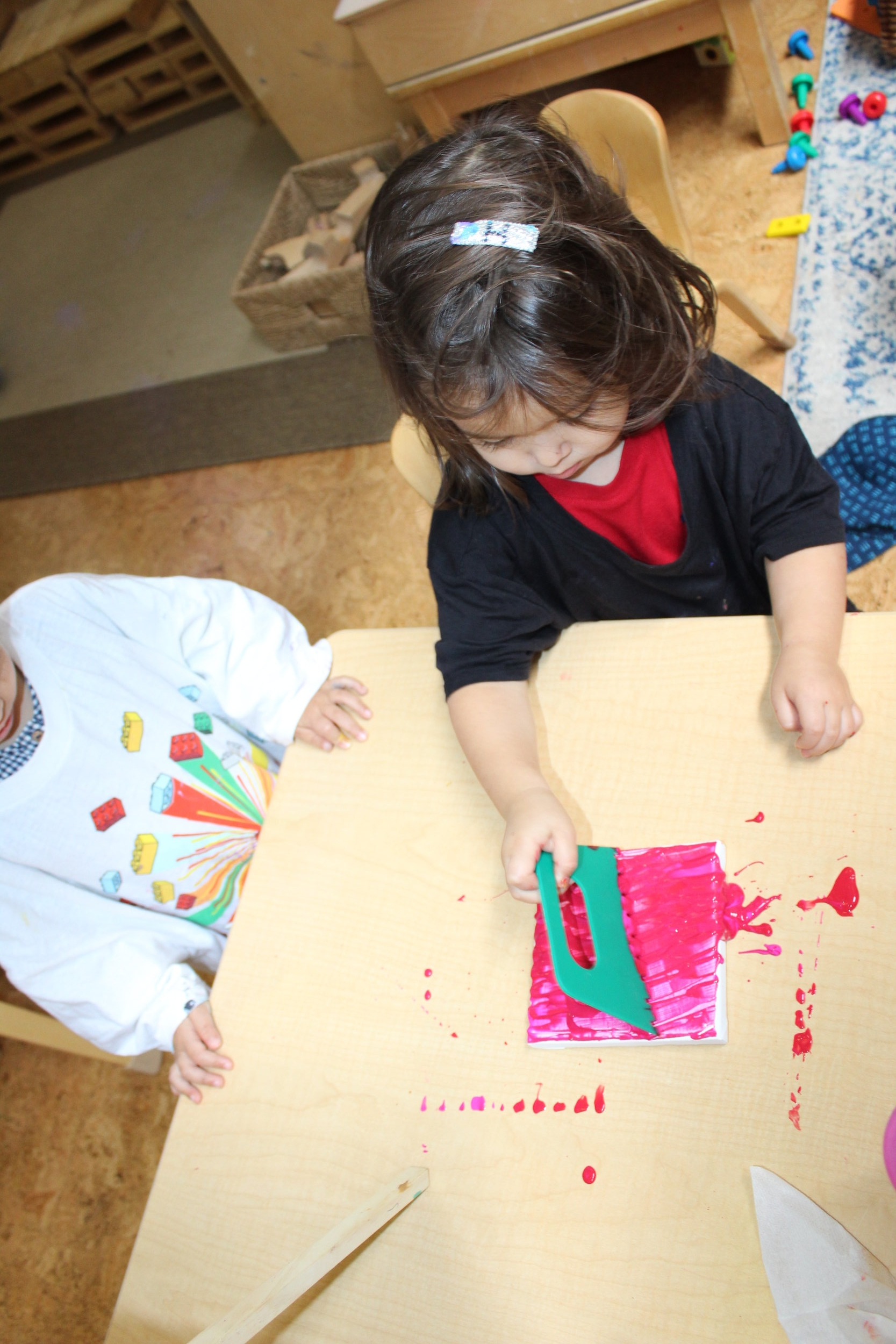 The children used one of the tools that are used for clay or play dough exploration, to create unique patterns on their art pieces.