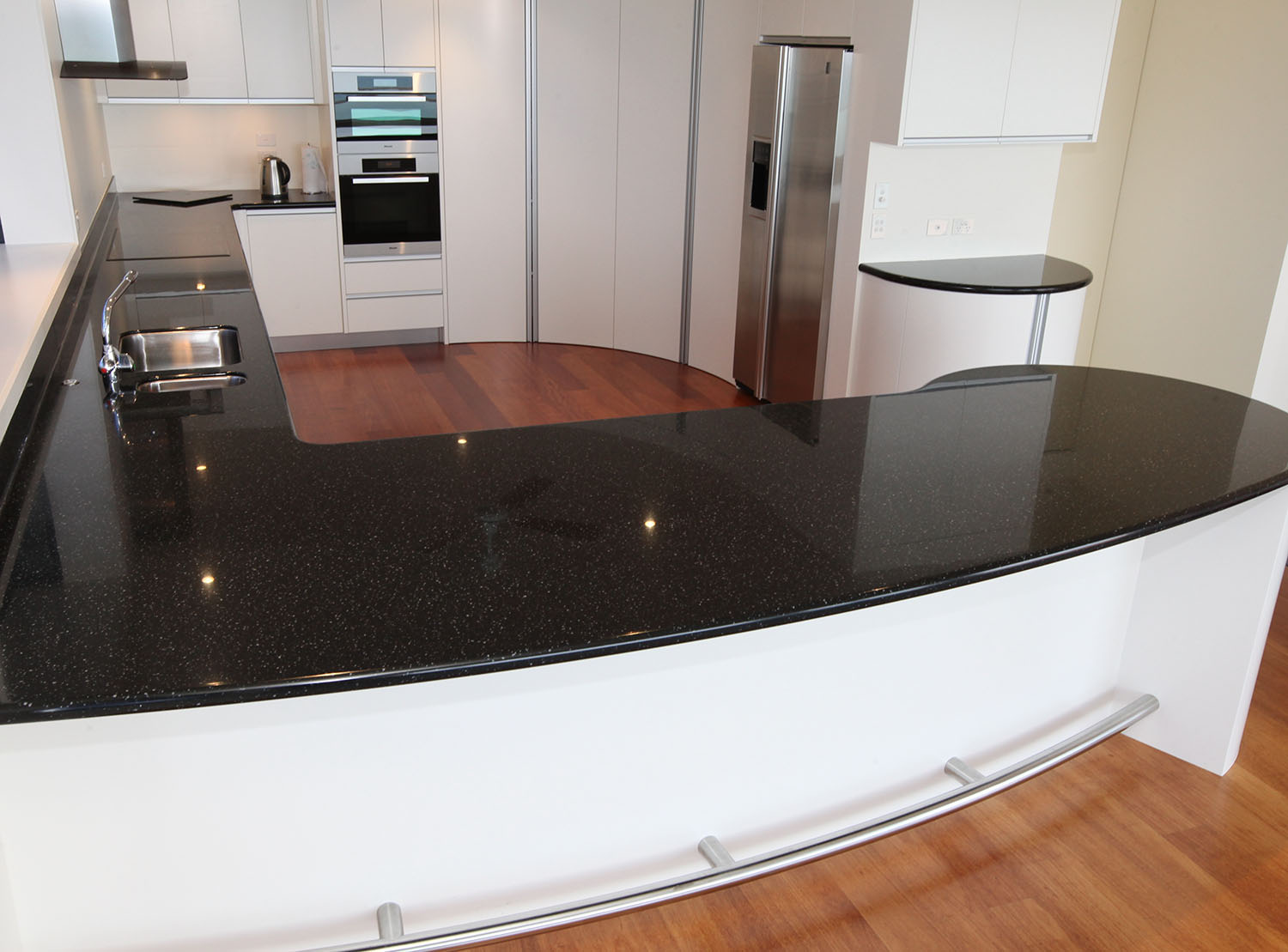 Lacquered kitchen showing curved doors and panels
