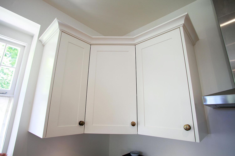 Overhead corner cabinet