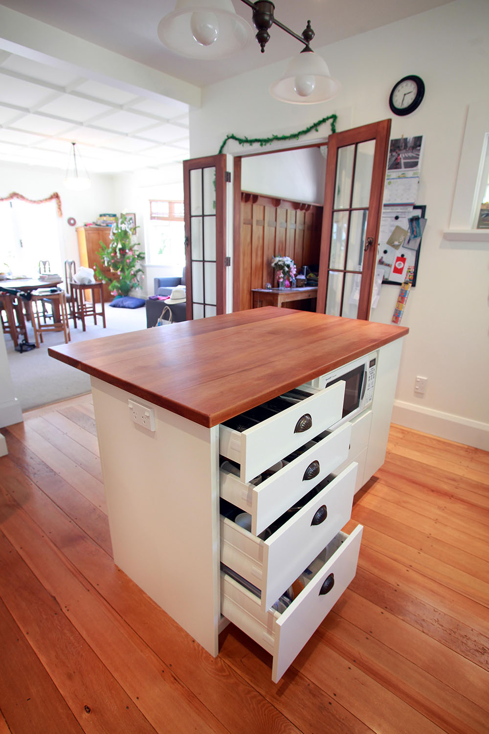 Matai top island unit with lacquered cabinetry
