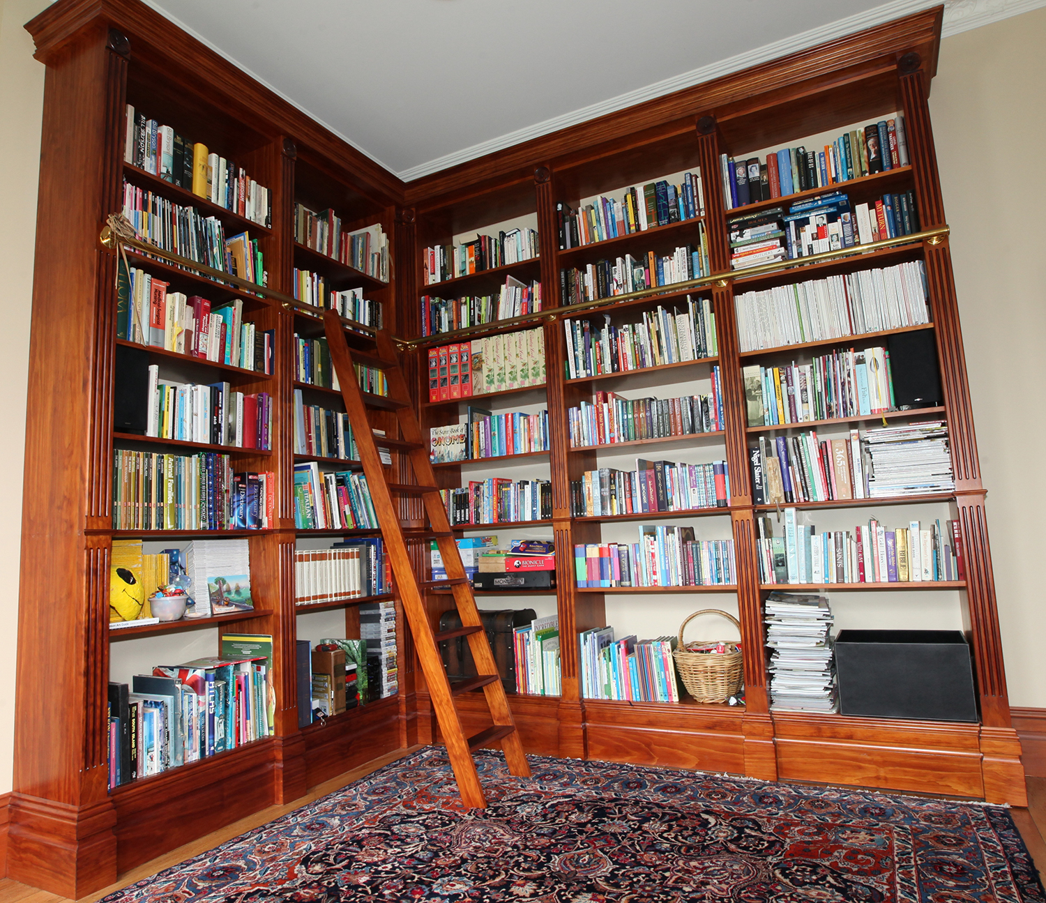 A beautiful floor to ceiling bookcase for a traditional country-style villa