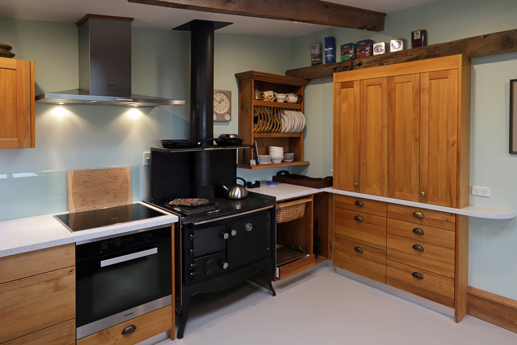 Country style kitchen with timber milled from a washed-up native log