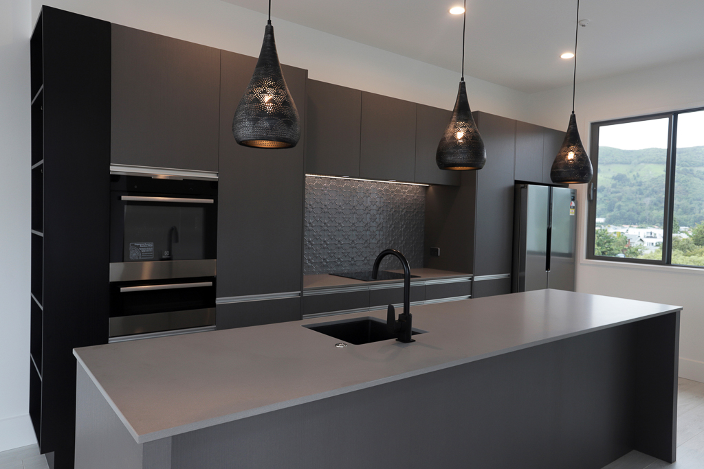 Industrial style apartment kitchen (one of three in same building)