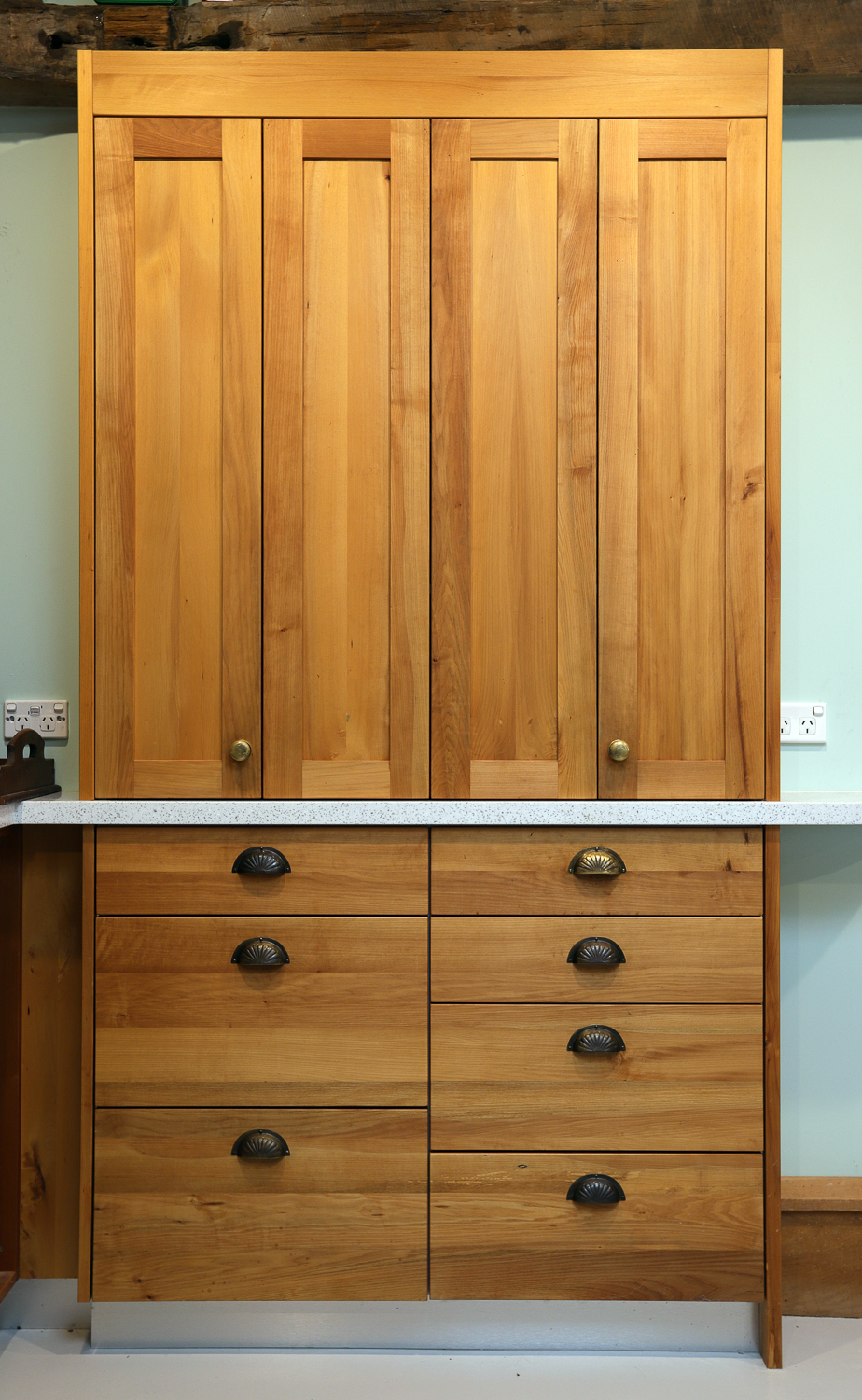 An on-bench pantry made from milled native timber found on a beach