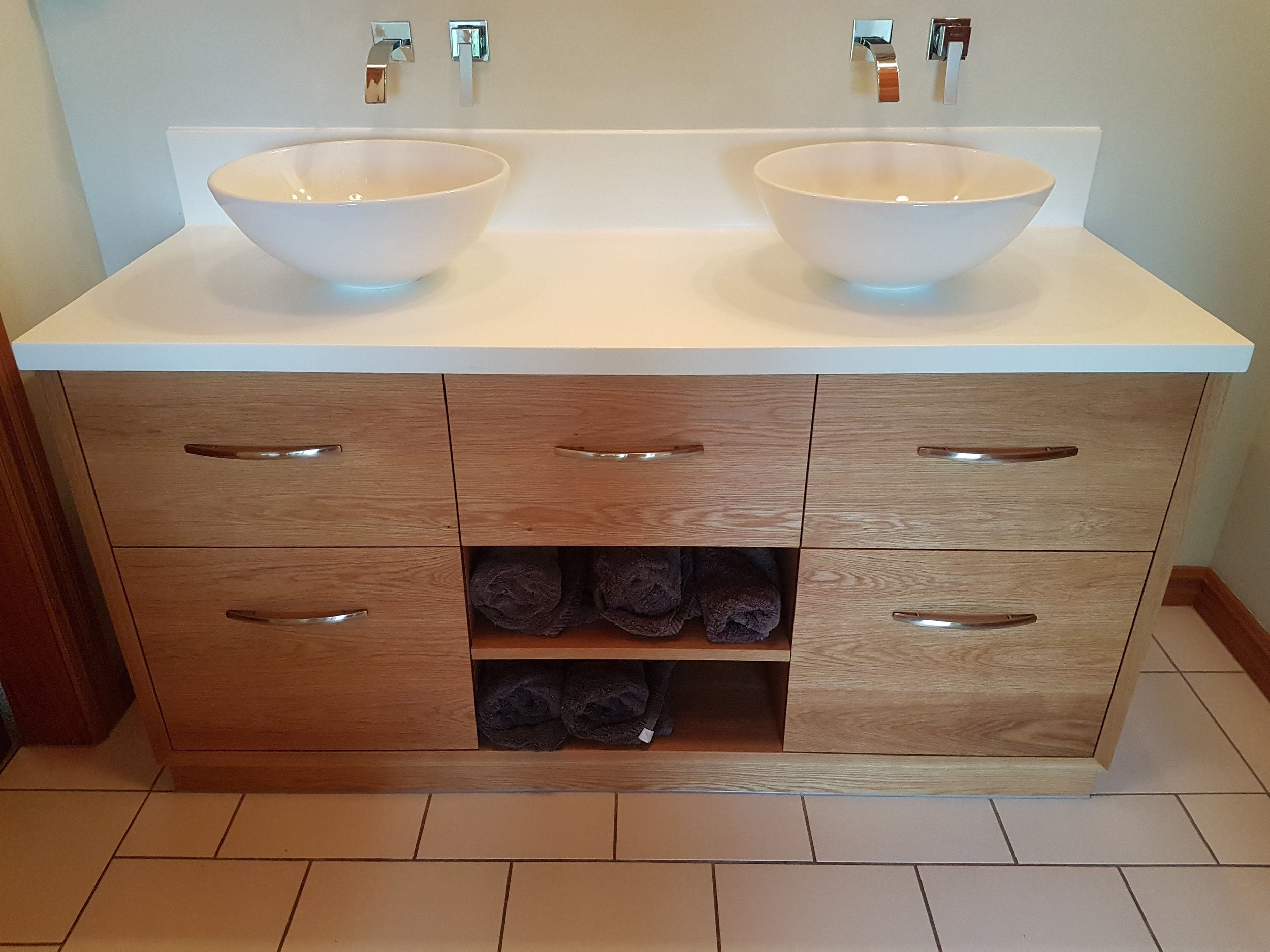 American oak vanity with acrylic top and coved upstand