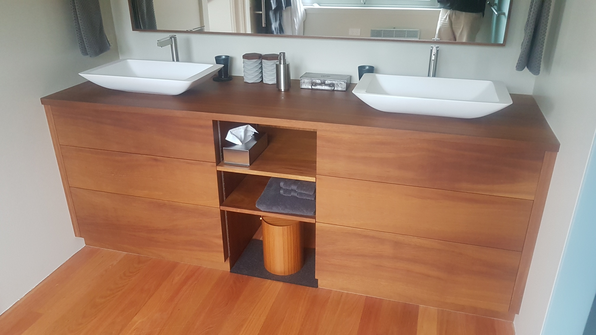 Iroko vanity unit with cut-out drawers