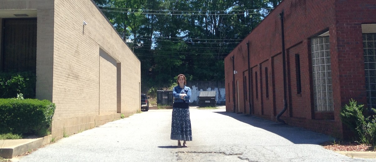 And there she is, standing between the local abortion clinic (right) and the building she's attempting to purchase for the crisis pregnancy resource center she founded, Seneca, Choices for Life.