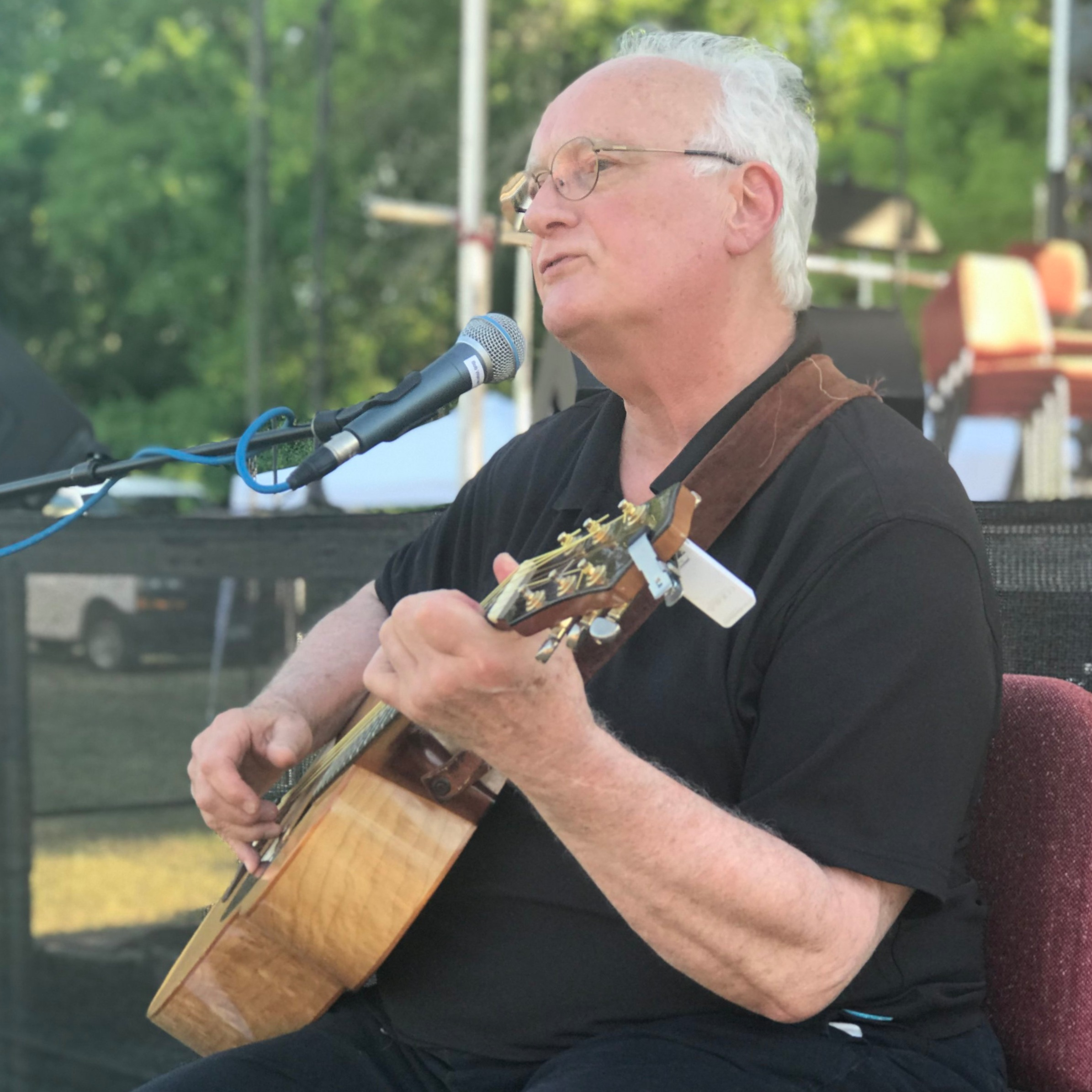 Local folk singer,  Bob Warren  stopped by and performed some old time folk favorites.