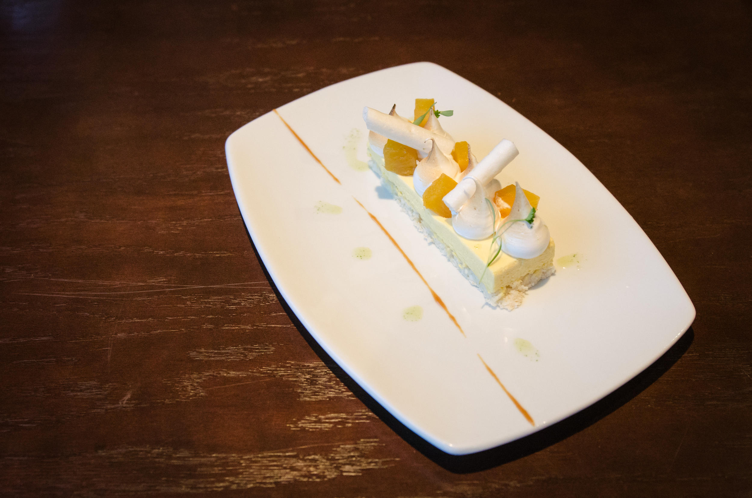 Kayne's  coconut passion bar with coconut dacquoise, passion mousse, coconut caramel, and Italian meringue