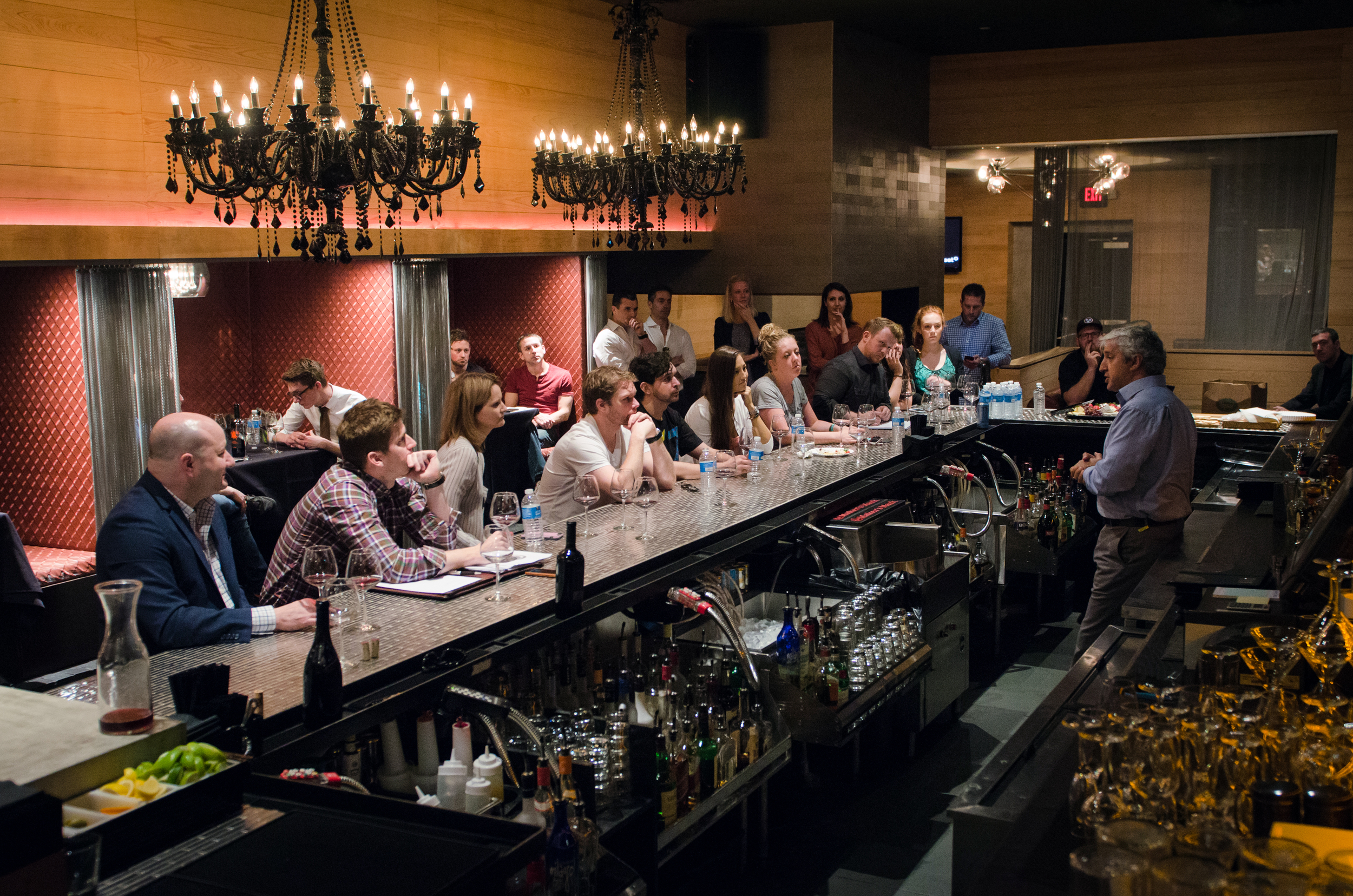Employees taking tasting notes during the tasting