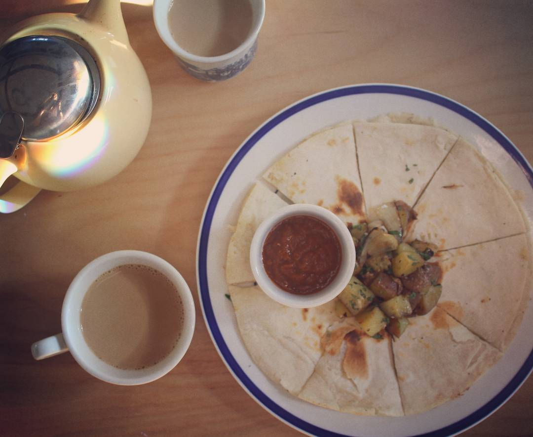 Breakfast  Breakfast quesadilla, parmesan & cilantro, homemade fries, Shahiya red chutney, maple coffee & a little of sunshine