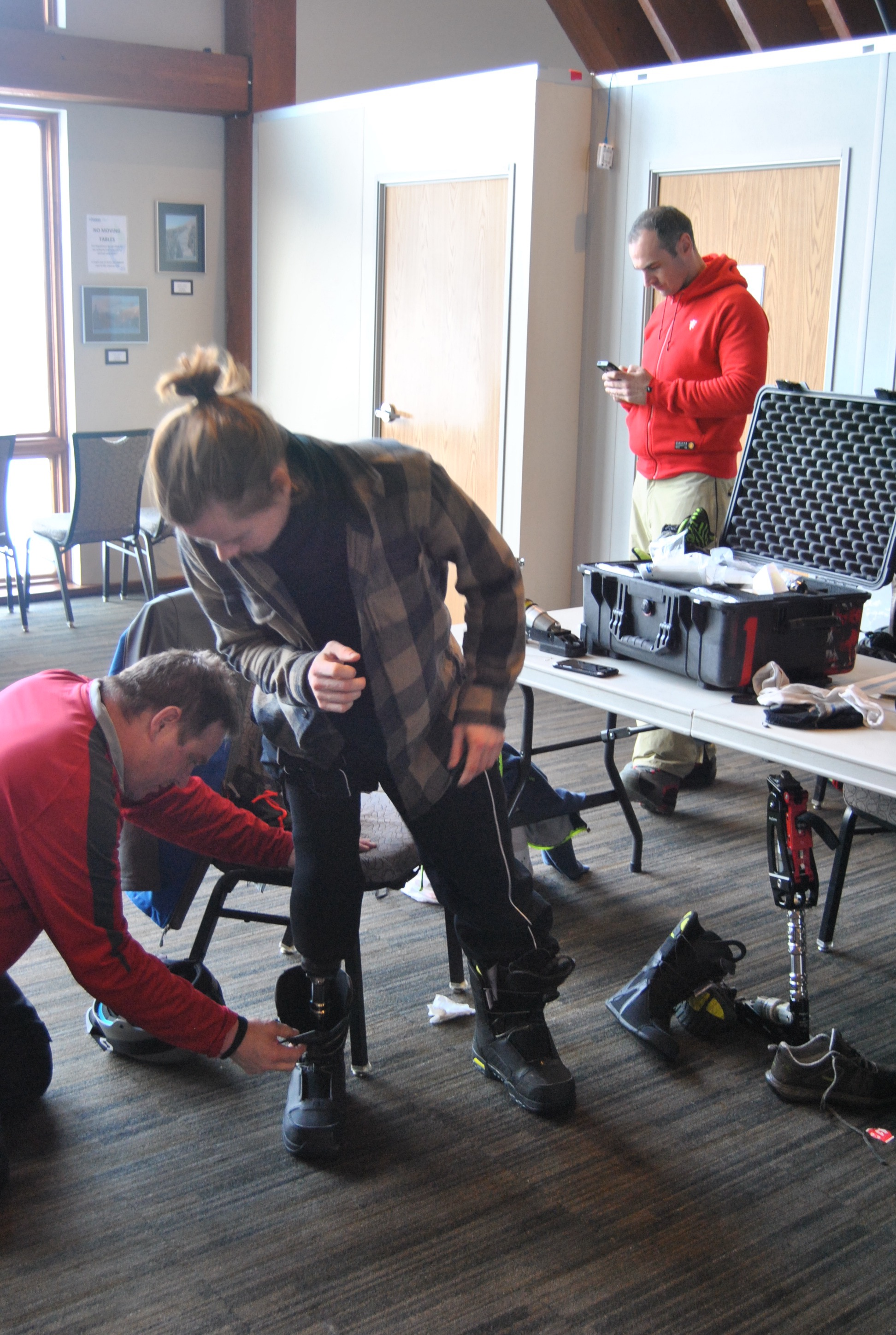 young man with transtibial prosthesis with snowboarding/skiing foot