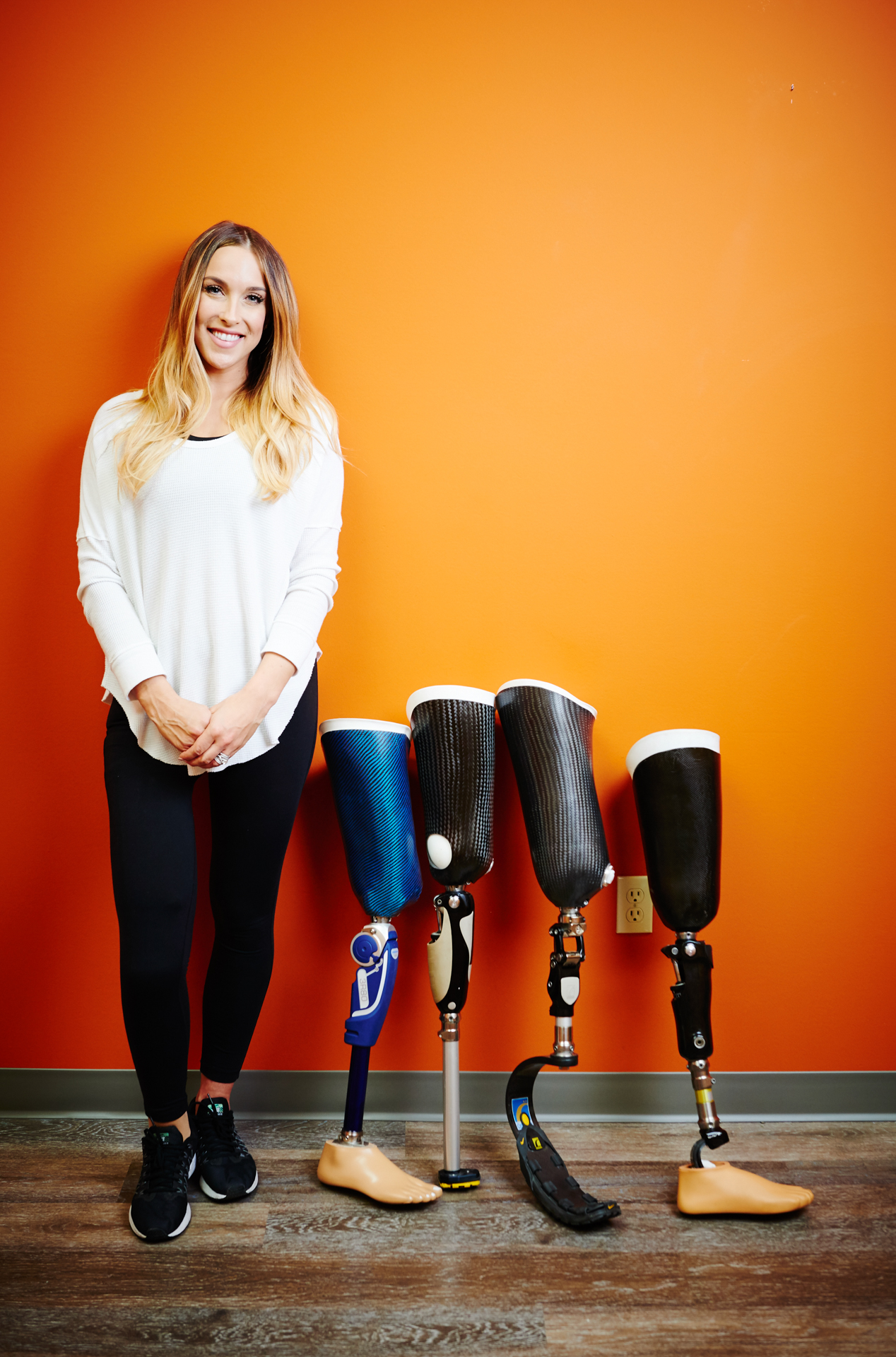young woman with transfemoral prosthesis collection