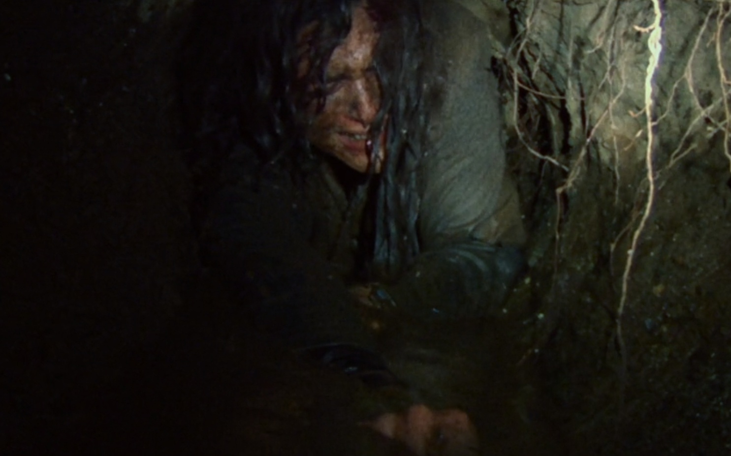 Sure, the tunnel scene is one of the film's best, but why are there tunnels and why would she crawl through them and why would you throw your only light source into a spot you weren't sure you could get to?