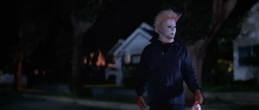 Don't know why this kid is dressed up exactly like Michael Myers but at least the movie shows more of the town.