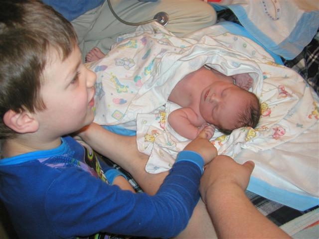 Proud big brother (x2) Nicholas (5)promptly changes her name to Julia!