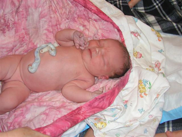 """About to be weighed - 8lbs 1oz. Perfectly healthy - Amazingly fast birth. 3 1/2 hrs from first real contraction - about 2 hrs of pain. Almost no pushing. Everyone had joked that this baby was just going to """"fall out."""""""
