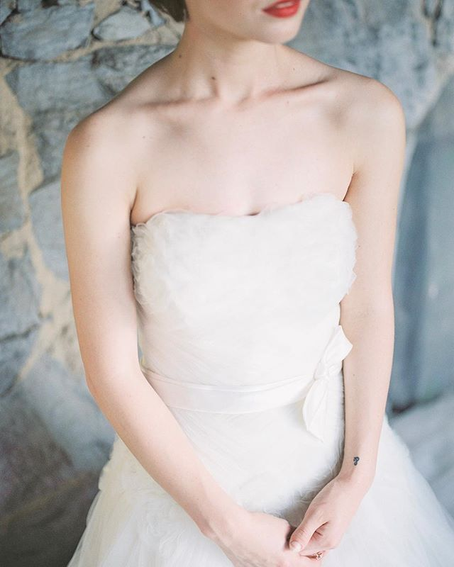 Looking back and still loving this look. The subtle tones of the stone mixed with the delicate romantic gown are just perfection. Shot on @fuji400h and developed by @thefindlab.