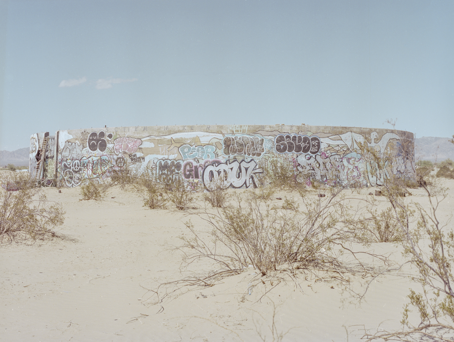 28 Aug 2016, Concrete Cylinder Structures with Grafitti, Slab City, NIland, CA. Pentax 645, Ektar 100 @ 400, Developed (Unicolor) and Scanned by me.