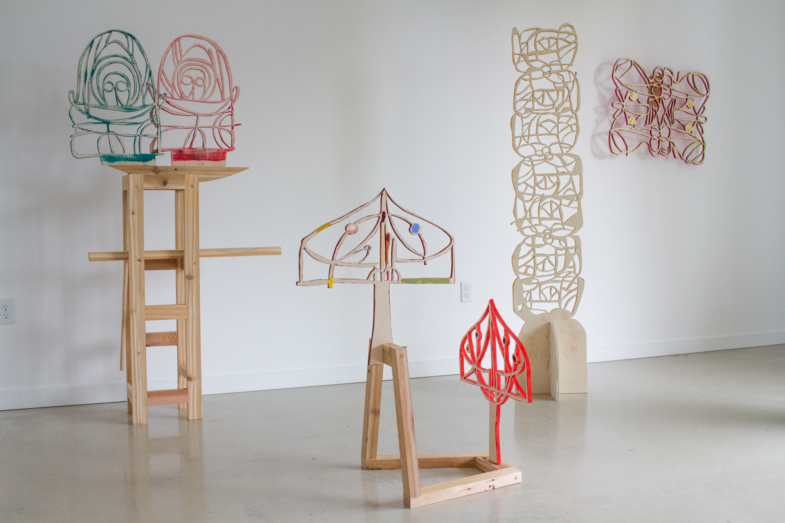 "Installation view from group show ""Beyond Control,"" Peace Sign Gallery, Portland, OR, Jan, 2018.  L to R:  Tender Angels Of Death ,  Two Walled Gardens ,  Stalagmite ,  Moth #2   Birch plywood, cedar, flashe, birch, oak, brass, dimensions variable."